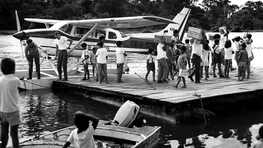 Float plane docked in the Amazon.